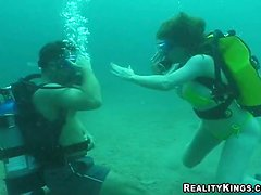 Kinky Jessica gives hot blowjob under the water while diving