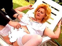 Chubby mature lady in stockings fucks by the poolside