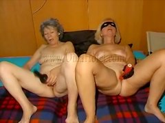 Matures with toys masturbate side by side