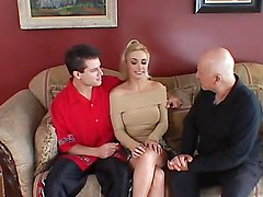 Hot blonde rides a hard cock while her man watches