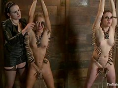Two tied up and gagged chicks get spanked and toyed