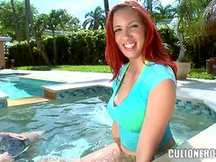 Big-assed redhead Kelly Divine blows and jumps on a cock ardently