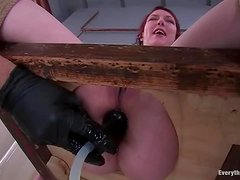 Bondage action in the toilet with a lusty redhead