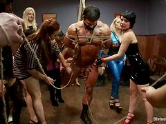Muscular guy gets tied up and humiliated by women