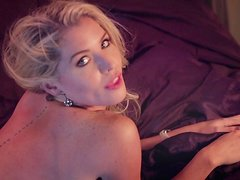 Backstage clip of cute blonde Carly Lauren posing for Playboy