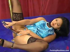 Asian babe in stockings gets drilled by a fast machine
