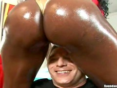 Two ebony sluts oil their big butts and jump on their men's cocks