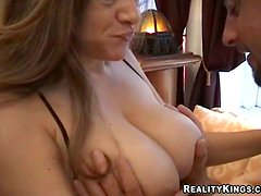 Carmel gives a titjob and enjoys awesome multiposition sex
