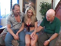 Blonde has a threesome with black cocks while her man watches