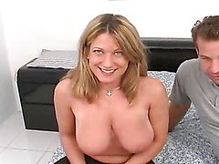 Sexy blonde's fucked silly by a big cock after showing her massive tits
