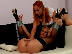 Hot spanking and pussy fingering for lesbian blonde in stockings