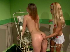 Seductive nurse in sexy uniform examines ass hole of brunette patient