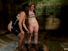 Redhead AnnaBelle Lee gets watered and wired by Bobbi Starr