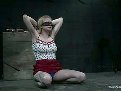 Blindfolded busty babe is being abused by her lesbian master