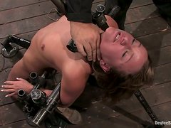 Hot girl with a mousetrap on her tongue in a BDSM device