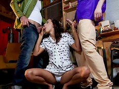 Sweet brunette in polka pop dress Lyen Parker gives blowjob to a duo of dudes