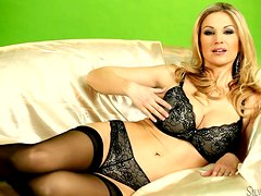 Beautiful Carol Gold poses in lingerie and fingers her pussy