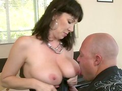 Big breasted brunette slut gives hot blowjob to her lover