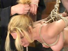 Luscious blond siren Jenni Lee is under severe pain
