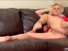 Solo milf Julia Ann masturbates on the couch