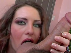 Green-eyed temptress gives her horny lover a nice blowjob