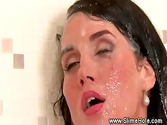 Glam slut masturbates at the gloryhole