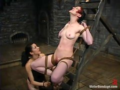 Nina enjoys being tormented by Princess Donna Dolore in BDSM scene
