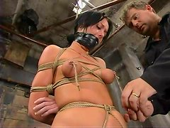 Melissa Lauren gets tormented and fucked with a dildo in BDSM scene