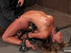 Oiled up Felony gets restrained and toyed with a vibrator