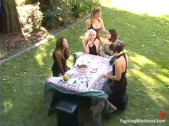 A few lesbians play with a fucking machine in the garden
