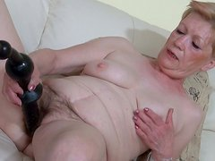 Marie is drilling her hairy snatch with toy