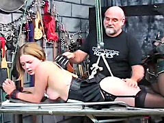 Hot blonde gets tortured in the dungeon wearing sexy black lingerie