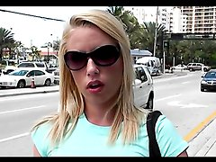 Gorgeous amateur blonde gives a blowjob to a stranger in a car.