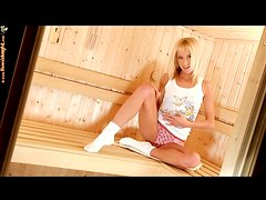 Teen pleasures her pussy in the sauna
