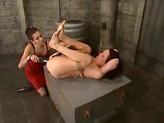 A hot brunette moans with pleasure while being tortured in BDSM clip