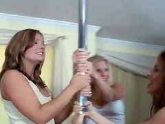 Three naughty pole dancers are having some fun