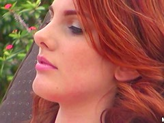 Redhead Rainia Belle rides a dick after taking sunbathes