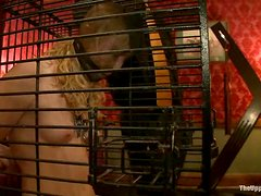 Horny blonde chick in cage gets tied up and blindfolded