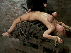 Amazingly hot blonde girl gets her boobs tortured