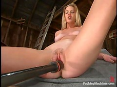 Phoenix gets her snatch pounded by a fucking machine in a shed