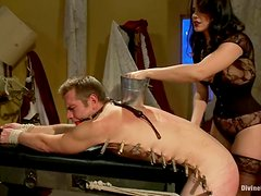Bobbi Starr attaches clothes pegs to John Jammen's body and fucks his ass