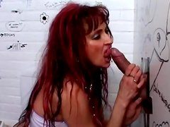 Natasha is sucking dick through the hole in the wall
