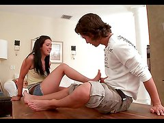 Sexy teen brunette gives guy one hell of a footjob