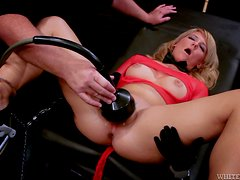 Casey Cumz moans loudly while getting her vag slammed by a sex machine