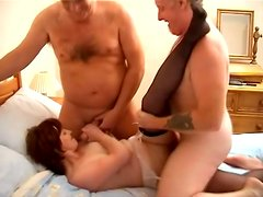 Mature woman gets hooked and fucked by two