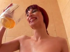 Kinky redhead slut drinks urine before getting her pussy stretched in fisting action