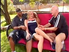 Simone Claire gets fucked by two studs in the garden