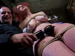 Curly redhead Rita Seagrave gets a wild orgasm in a hot BDSm scene