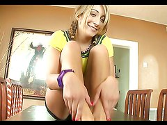 Blonde teen gives lucky guy a footjob