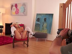 Blonde babe Blanche Bradbury fingers her pussy in the living room